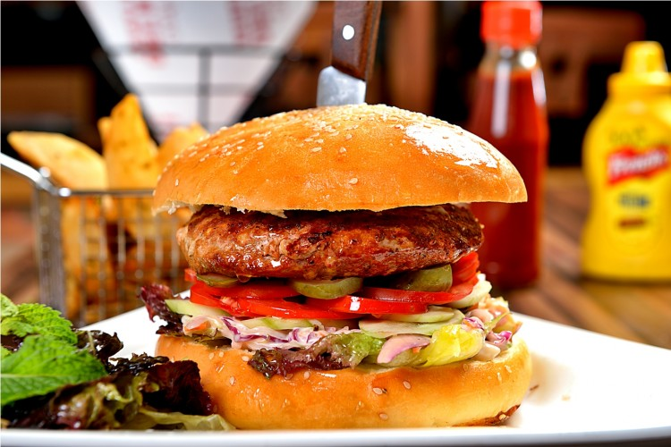 This South Delhi Cafe Is Giving Free Burgers For An Entire Year!