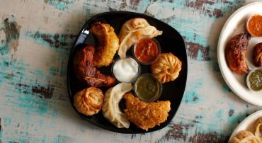Ever Tried Pizza Momos? This Newbie At Shahpur Jat Serves it & More!